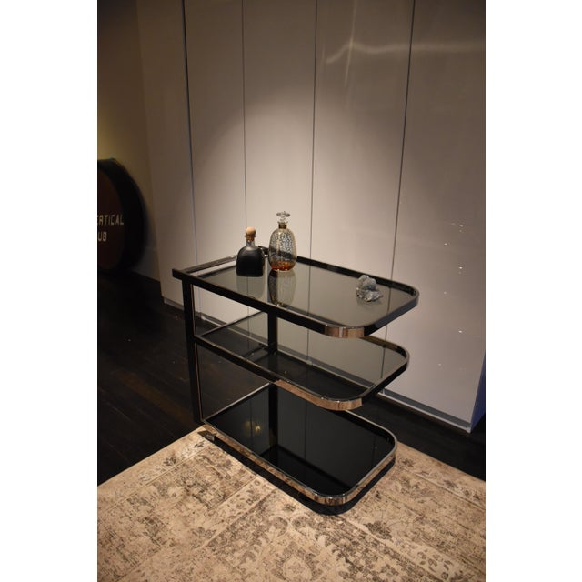 This 1970s chrome and black-glass bar cart is so stunning. We hate to give it up but it's time for a new home! It's in...