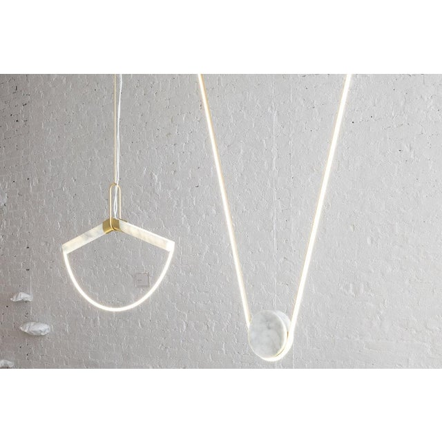 """By Farrah Sit Starting Price: $10,000 as shown Specifications: 34""""w x 3""""d x 34"""" h Shown In: Satin Brass, Carrara Marble..."""