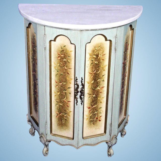 Express a distinct style and taste with this striking yet elegant Portuguese marble top paint decorated demilune cabinet /...