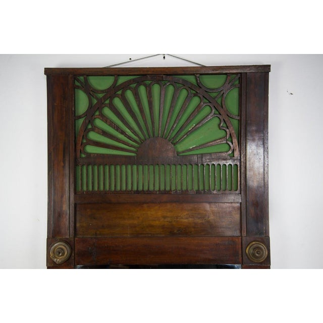 Bring a sense of simplicity into your entry way with this French Country carved window mirror. The top features intricate...