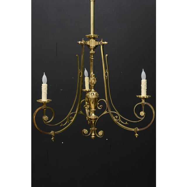 French Napoleon III style bronze chandelier. Has three arms. Made in the 1900s. Has some tarnish to it due to its age.