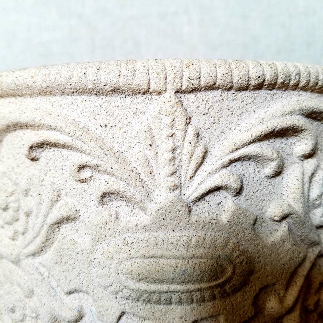"""High quality composite stone footed planter with floral detail throughout. The bottom bears the makers mark """"Hen-..."""