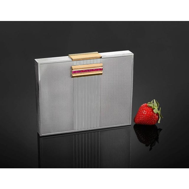 Classic and chic, this stunning minaudière was created by the iconic Parisian jewelry firm of Van Cleef & Arpels. The...