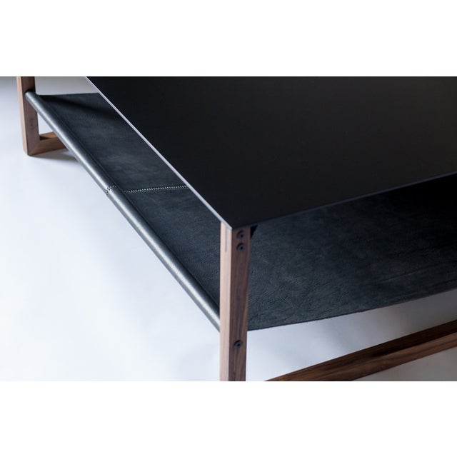 Minimal and elegant form paired with a balanced and thoughtful design. The Sling coffee table features powder-coated...