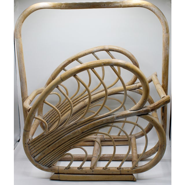 A large vintage rattan basket, with a lovely natural finish. Banana leaf design. Perfect for blankets, firewood, magazines...