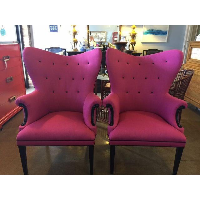 These vintage wingback chairs have been reupholstered in a hot pink heavy linen with reinforced backing to retain the...