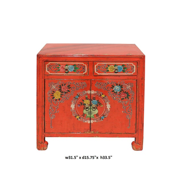 This is a side table cabinet with two doors and two drawers. The surface is finished with rustic distressed orange red...