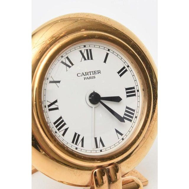 This regal hallmarked Cartier 24 Karat gold plated and lapis lazuli quartz travel desk clock/ is no longer being made. it...