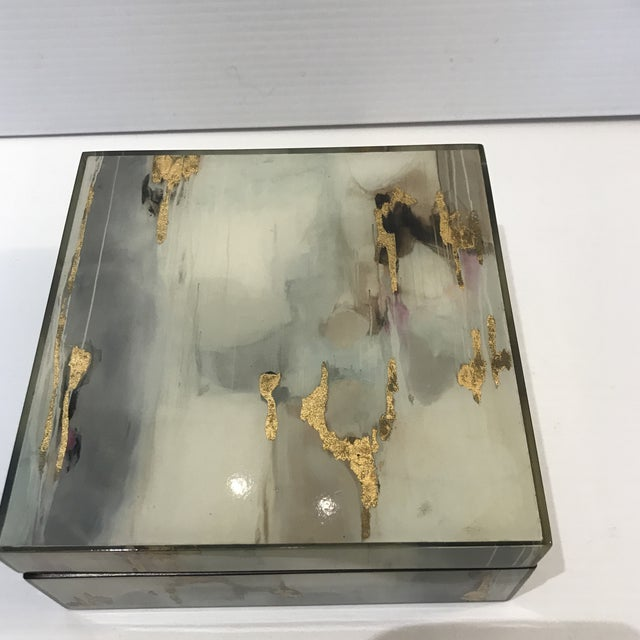 Acrylic box with lacquer interior with a Geo abstract finish with gold leaf accents. Colors are blue and gray is with a...