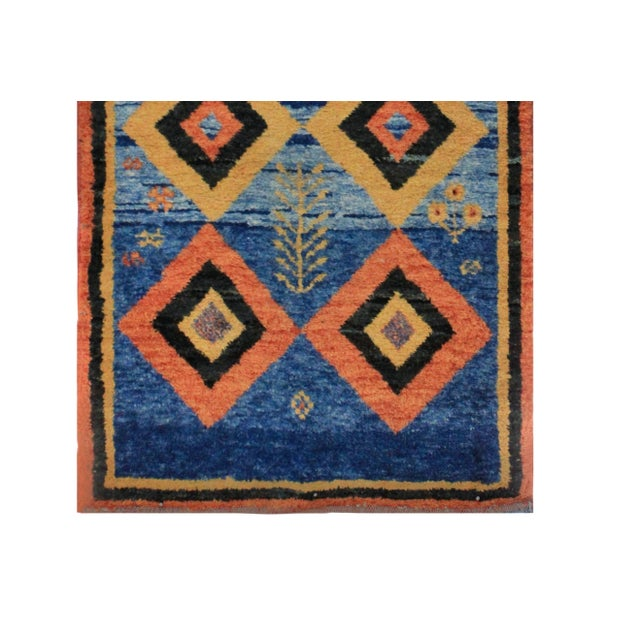 A hand woven Persian wool carpet with great colours.
