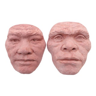 Early Man Terracotta Wall Sculptures - a Pair For Sale
