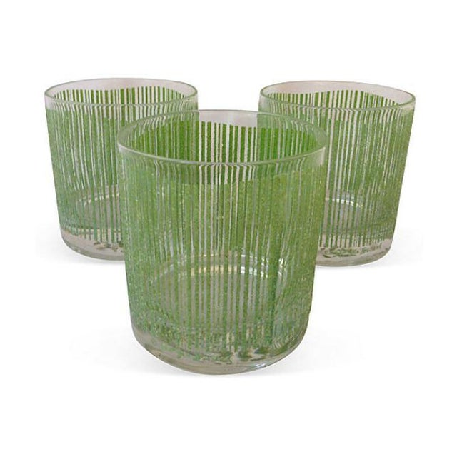 Fun set of three Georges Briard bar glasses with a modern, textured green line pattern. Add a pop of color by stacking...