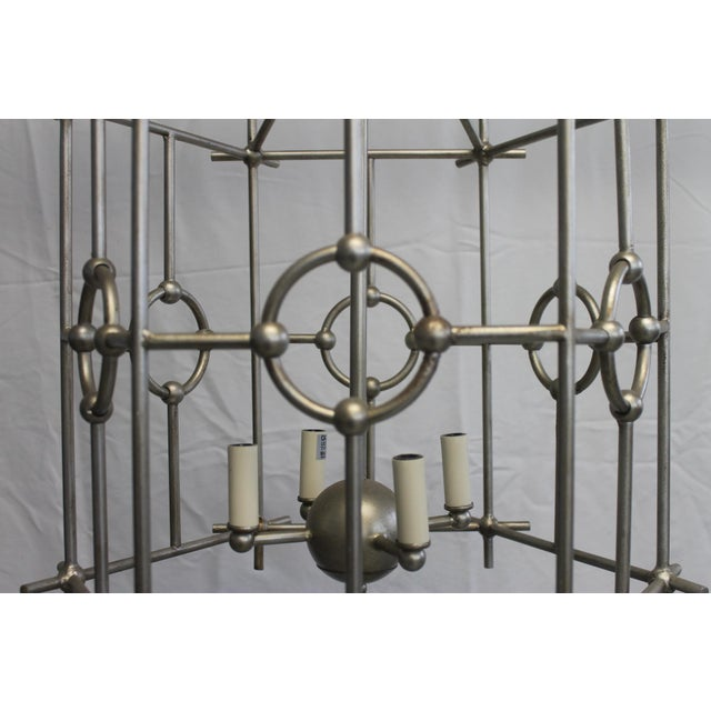 East meets West. A traditional Lantern shaped lighting piece with a distinctive Asian Pagoda shape. Six-sided metal Park...