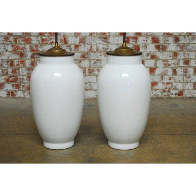 Monumental pair of Chinese blanc de chine baluster form vase table lamps. Large statement pieces with pleated shades and...