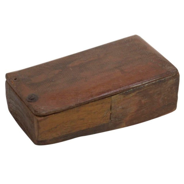 Vintage carved wood box originally used to store spices. The attached lid slides open to reveal two storage compartments....