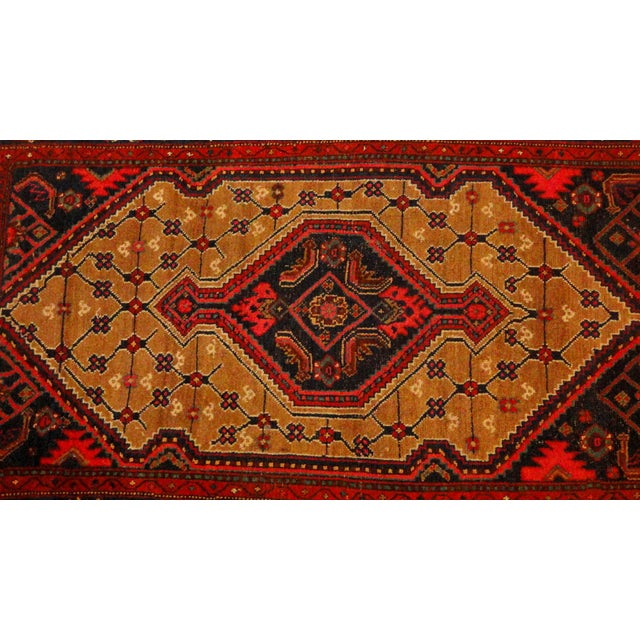 Wool on wool pile, handmade, antique Persian Camel hair rug in excellent condition.