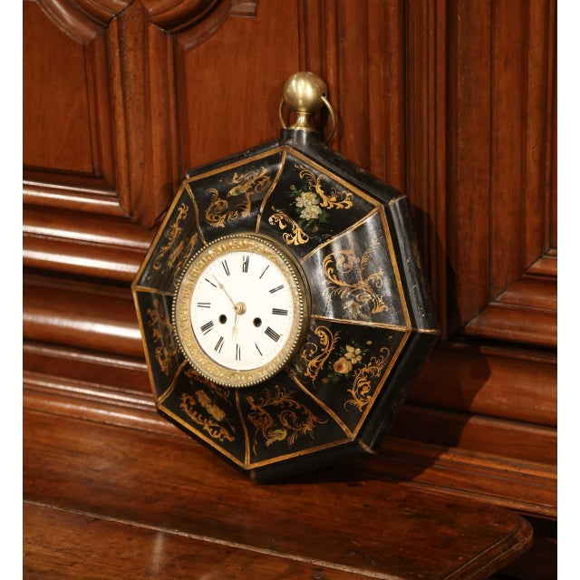This feminine, octagonal clock was created in France, circa 1870. The hanging, antique tole wall clock features a round...