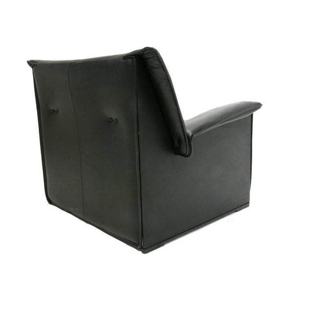 Stylish and sleek, yet very comfortable black leather lounge chair.