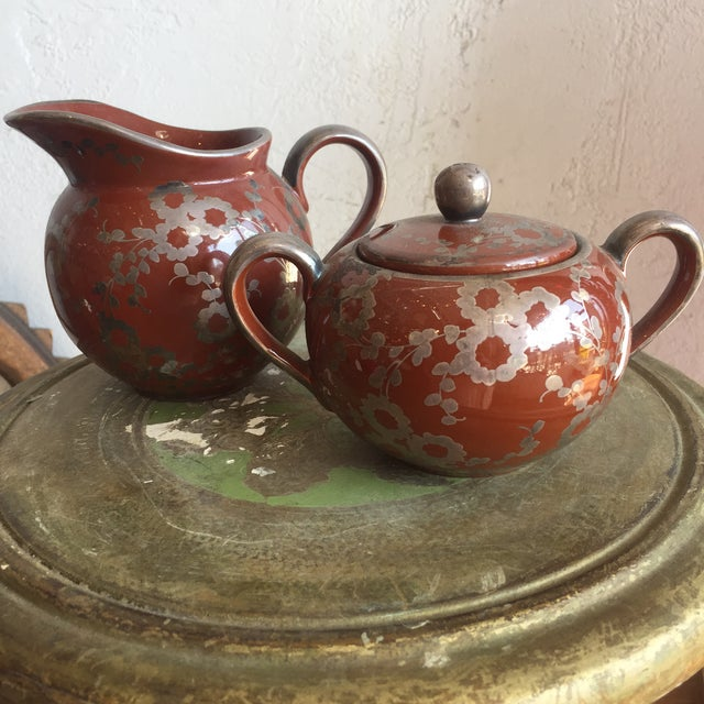 Mid Century japanese creamer and sugar bowl with a lovely detailed flower vine motif in a rake glaze finish. In excellent...