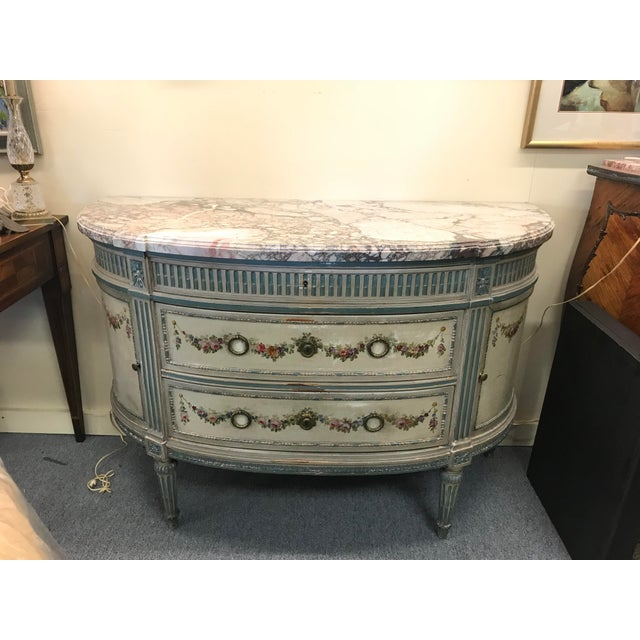 French green painted gilt chest with gorgeous pink, white, and gray marble top. Featuring two drawers and two side...