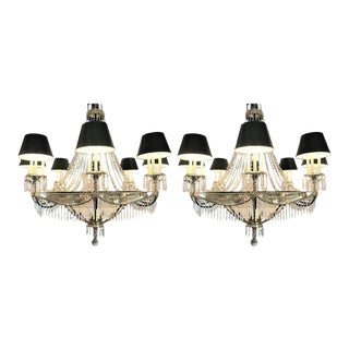 A Pair of Art Deco Palatial Eight Arm Ebony and Brass Chandeliers w Shades