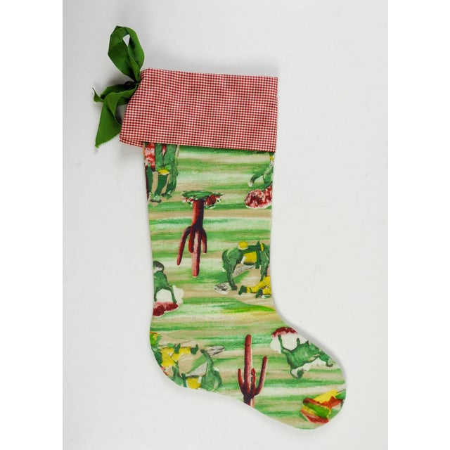 Custom designed Christmas stocking made from vintage cowboy flannel and gingham. Ribbon hanger with vintage wood toggle...