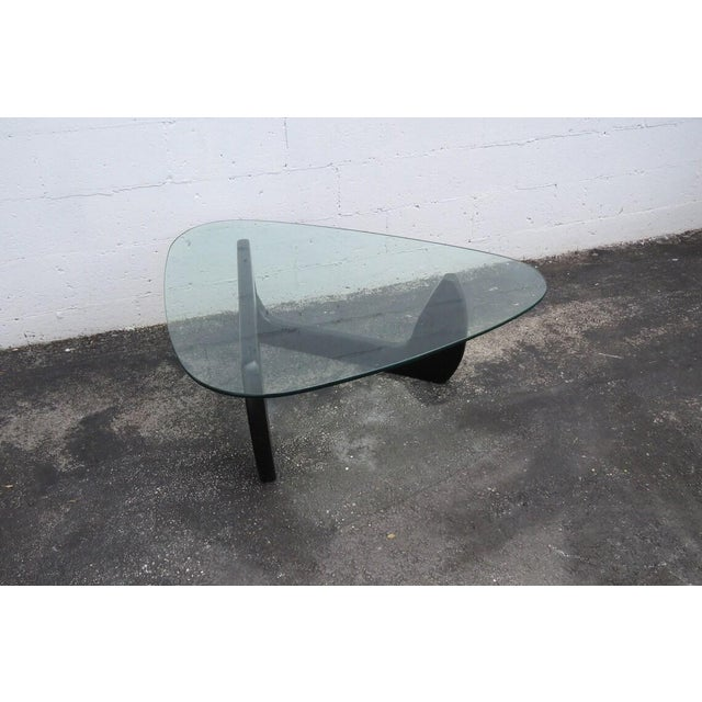 This gorgeous Coffee Table is made with a wood base and a glass top, and it is in good condition. The Table has...