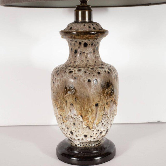This striking ceramic table lamp was handcrafted and glazed in Germany, circa 1950. It offers an urn form body with a...