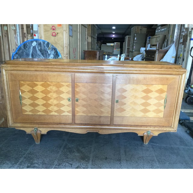 Sleek and elegant French art deco credenza features diamond pattern inlay on all 3 front doors. This piece is made of oak...