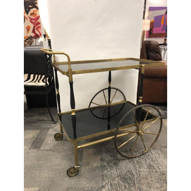 """Midc/-entury Italian brass bar cart by Morex with black glass tops. Each top is 28.25"""" by 16""""."""