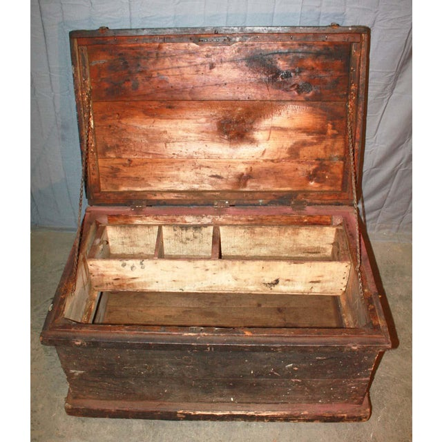 Worn wooden vintage trunk with wheels with sectional compartments and functioning hardware. The casters can be easily...