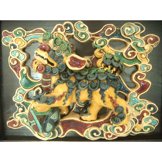 Magnificent She Wan Chinese tile mounted on a custom inset wood frame and brass hanger. Foo Dogs are also known as Chinese...