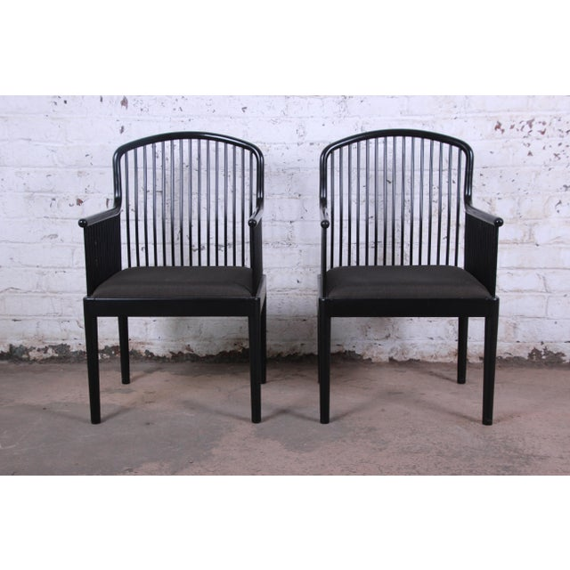 Offering an exceptional pair of Andover black lacquered spindle armchairs. The chairs were designed by Davis Allen and...