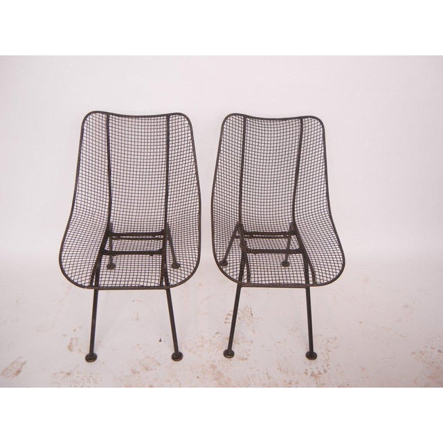 Wrought iron and mesh chairs by Russell Woodard. We do have more chairs available.