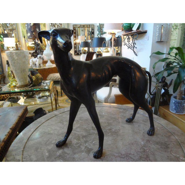 Beautifully executed Hollywood Regency bronze whippet or greyhound statue/figure from the mid-20th century. This life-...