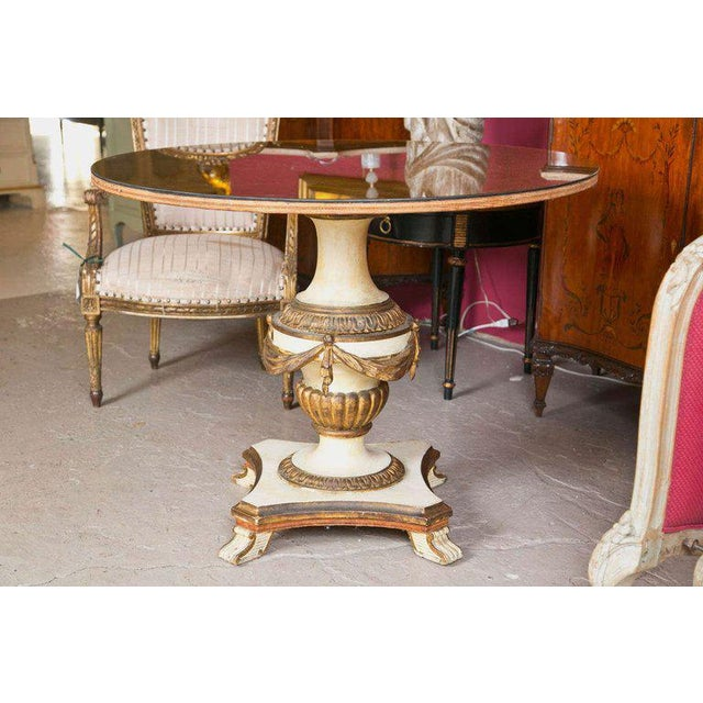 A finely decorated Continental Centre / Dining Table. The gilt gold and white distressed paint decorated base with tassel...