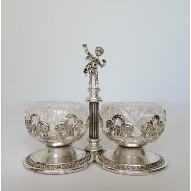 Vintage: C.1950s, English silver plate cherub/ winged cupid, dual salt and pepper cellars, with cut crystal interior...