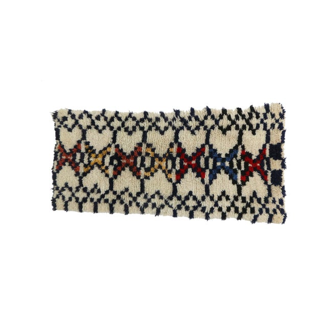 Azilal rugs are handwoven by Berber women of the Azilal tribes in the Middle Atlas Mountains of Morocco. They are a...