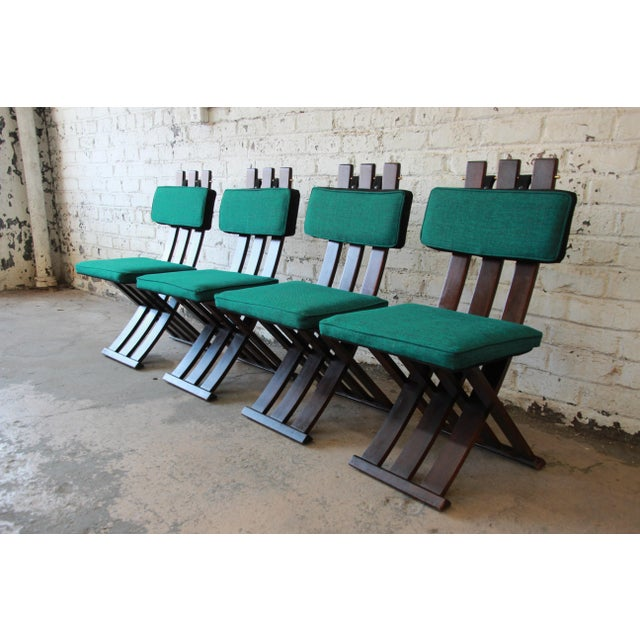 Offering a stylish set of four Mid-Century Modern dining chairs by iconic designer Harvey Probber. The chairs feature...