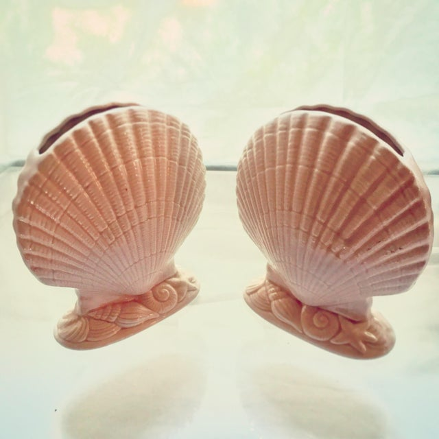 This pair of vintage Larry Laslo for Mikasa ballet slipper pink ceramic Seashell Vessels transport you to the subtle...