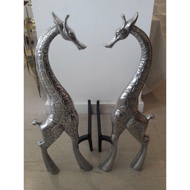 Pair of aluminum giraffe andirons by Arthur Court .