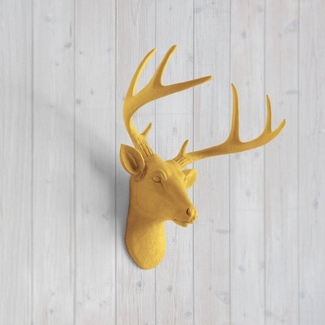 The MINI Virginia Curry Orange faux taxidermy Deer Head Wall Sculpture. This wall mount features the dignified gaze of the...