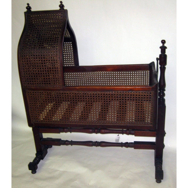 19th century Gothic Revival English cradle featuring turned posts and stretchers. All original hardware and caning. Please...