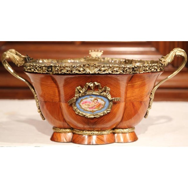 Plant flowers inside this elegant Louis XVI oval jardiniere. Crafted in Paris, France circa 1820, this fruitwood planter...