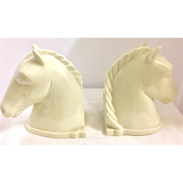 Vintage Abingdon Pottery, polished ivory colored horse head bookends. Label on back. These were made between 1938-1950.