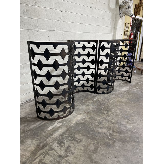 Not sure what these were used for. Curved iron cut-out architectural free standing panels. I configured them in a...