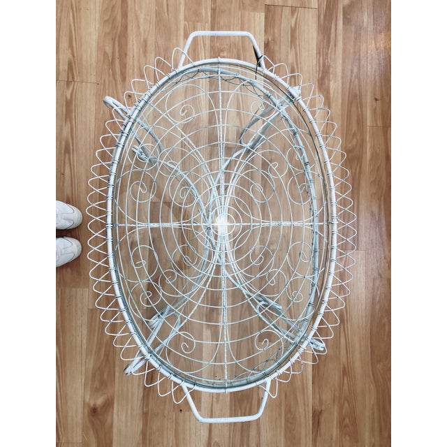 Absolutely darling, white wire coffee table with removable glass tray top. This sweet little table can work either indoors...