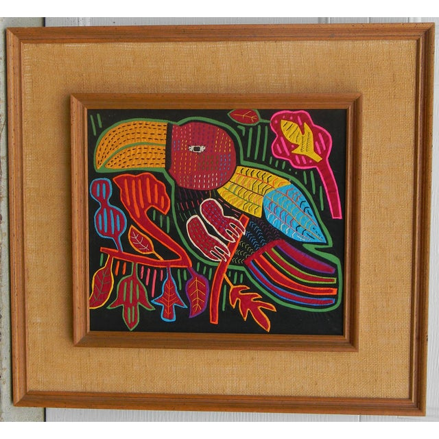 Molas are handmade using a reverse appliqué technique. Several layers of different colored cloth are sewn together; the...