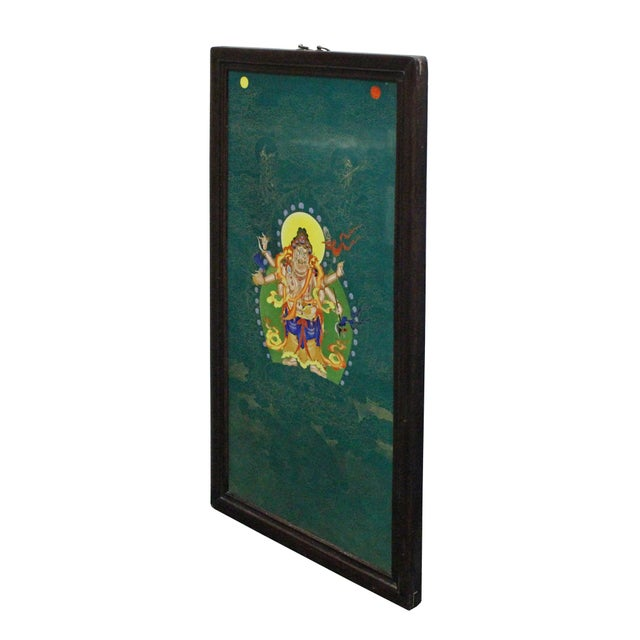 This is a nicely made porcelain painting of a Tibetan Deity Figure. It is a good combination of drawing skill and the...