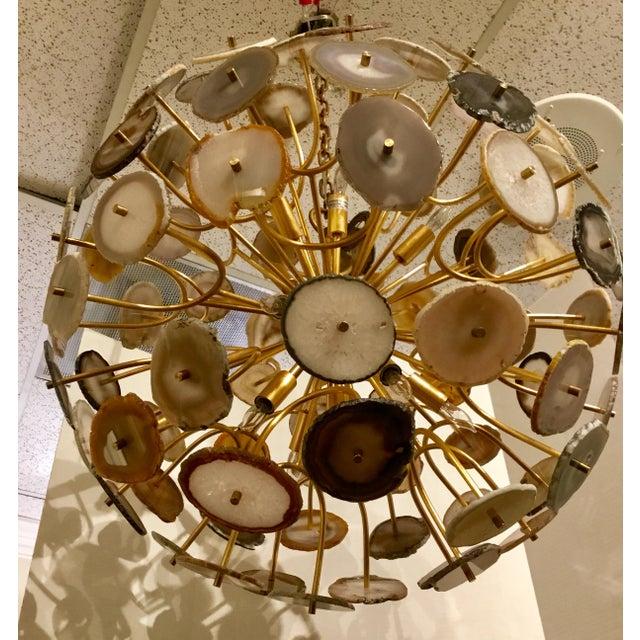 Original Retail $4290, Stylish modern agate sliced orb chandelier by: John Richard, approximately 14 lights, brass...